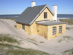 Beach House buried in sand